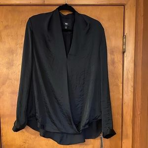 Dressy black blouse with necklace